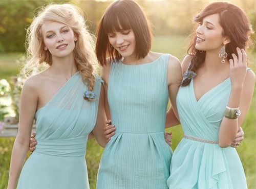 Unique teal bridesmaid gowns, that way each girl could have her own style within the parameters set by the bride