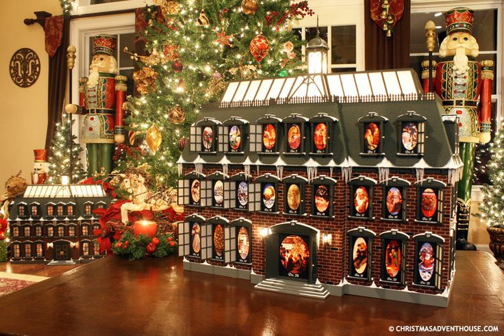 """Christmas Advent House. Just like the one in """"Christmas Vacation"""" too bad its crazy expensive! pretty!"""
