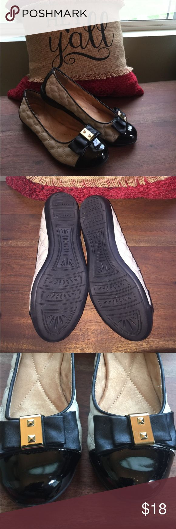White Mountain Shoes Tan and black slip on flats.  Quilted with bow on toe. Worn one time. Excellent condition.  Size 8.5M White Mountain  Shoes Flats & Loafers