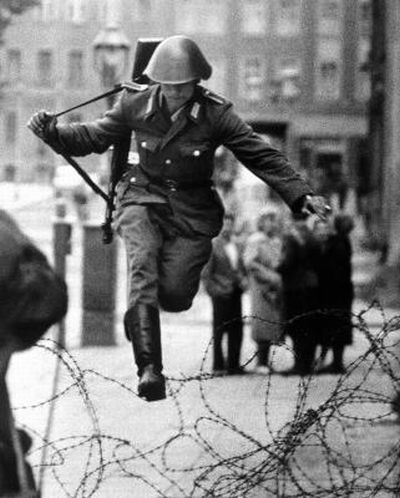 German Soldier Fleeing East Berlin, right before the installment of the Berlin Wall