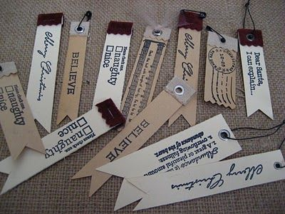Skinny tags trimmed with flag shaped end.  Add eyelets or a bit of fabric stapled over the edge