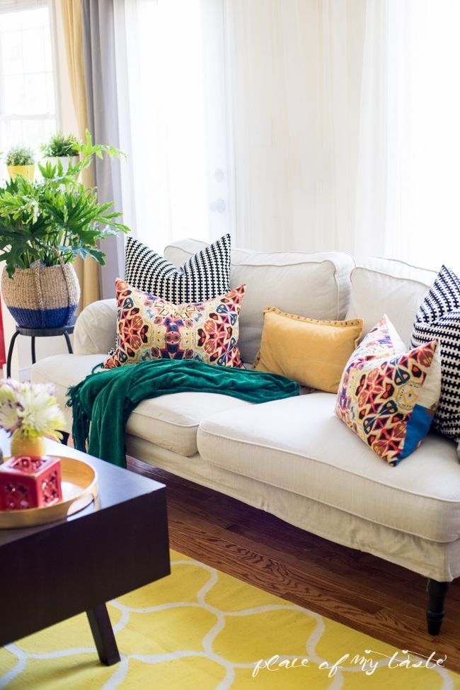 I love the combination of colors with the bright yellow and red patterned throw pillows mixed with the teal throw blanket. The perfect nap-taking couch for your living room.