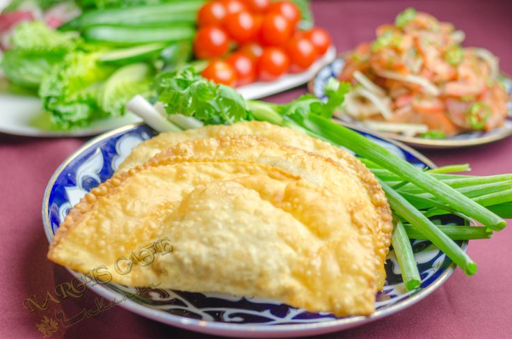 """Chebureki - a sort of big meat dumpling, popular in Uzbekistan and other """"stans"""", Caucasus and countries of former Soviet Union. In the background - achichuk salad from fresh tomatoes and onions.  www.nargiscafe.com  #cheburek #achichuk #meat #nargiscafe #dumpling"""