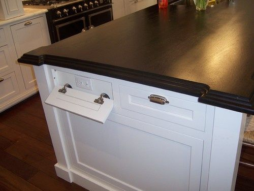 Kitchen island with outlets disguised as drawers - great idea!