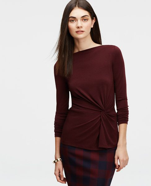 Modern spin: twist knot detail cinches a flattering silhouette on this wear-with-all style in a gorgeous array of colors. Boatneck. Long sleeves. Front peplum seam.