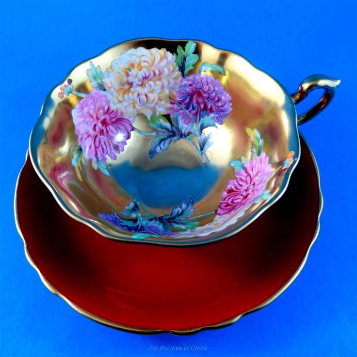 Chrysanthemum on Gold Center & Burgundy Paragon Cup & Saucer (Stamps not Match) FOR SALE • CAD $695.00 • See Photos! Chrysanthemum on Gold Center & Burgundy Paragon Cup & Saucer (Stamps not Match) This delightful cup and saucer set is in very good condition, free of chips, cracks or crazing, 302437841532
