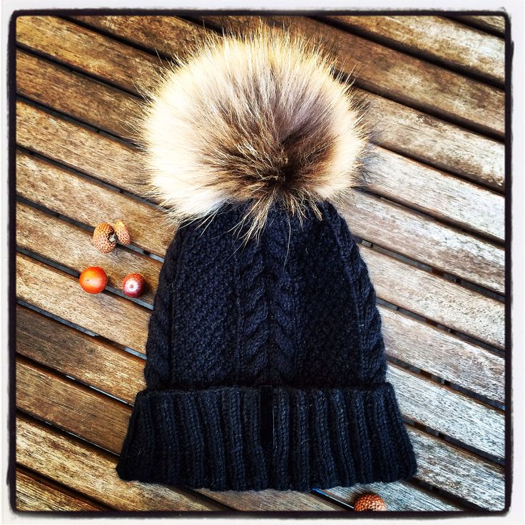 knitted winer hat with fur pom pom