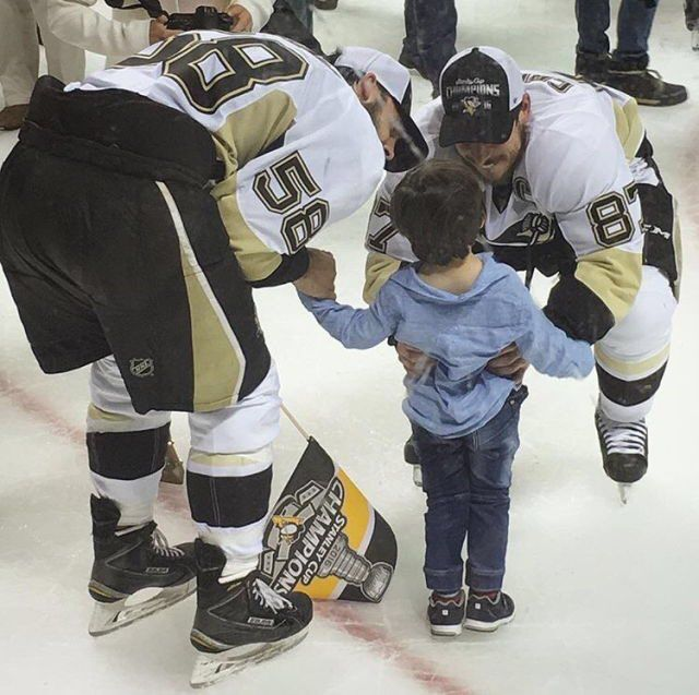 Sid and Kris with little Alex Letang.
