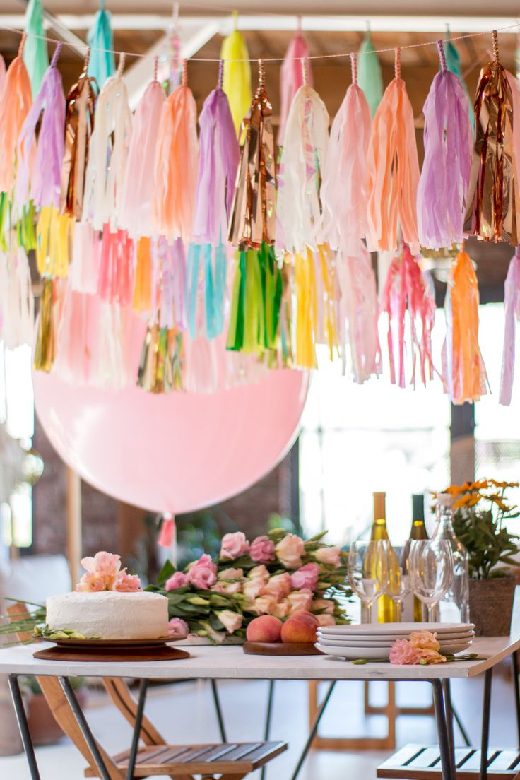 colorful tassels above a dessert table or as a photo backdrop