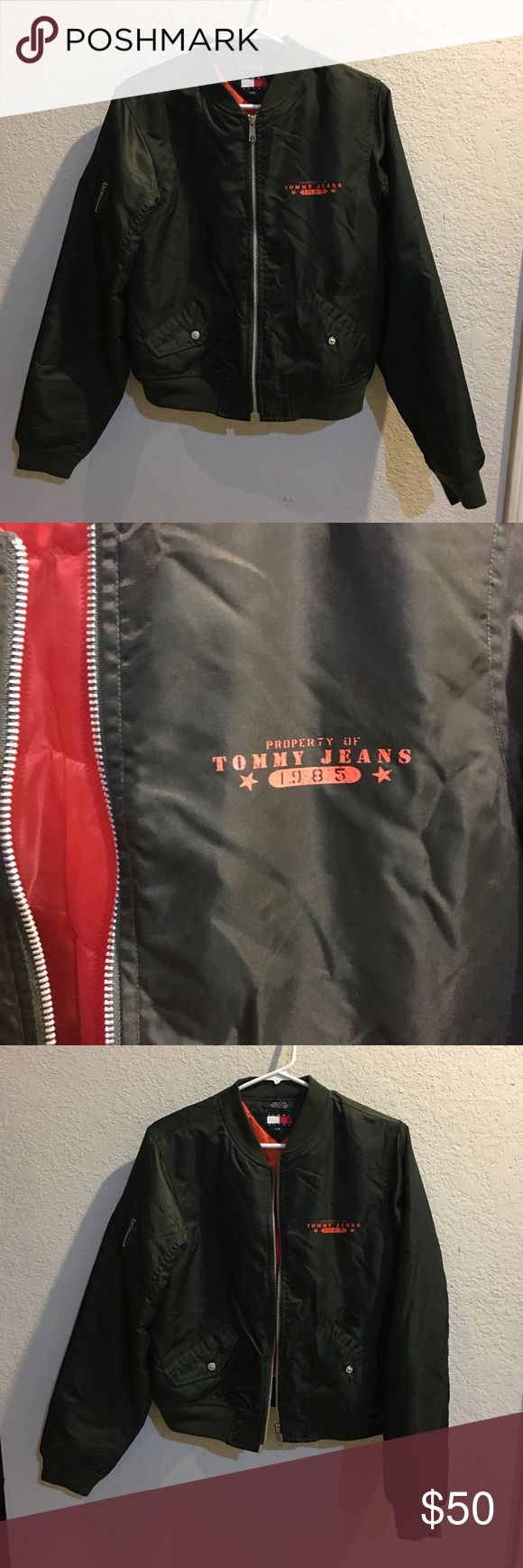 Tommy Hilfiger Army green bomber jacket - Size L Tommy Hilfiger Army Green Bomber Jacket with Orange inner lining! Size - L Jacket is like new, gently worn and cared for! No tears, marks or scuffs! Smoke free and pet free home! Tommy Hilfiger Jackets & Coats Utility Jackets