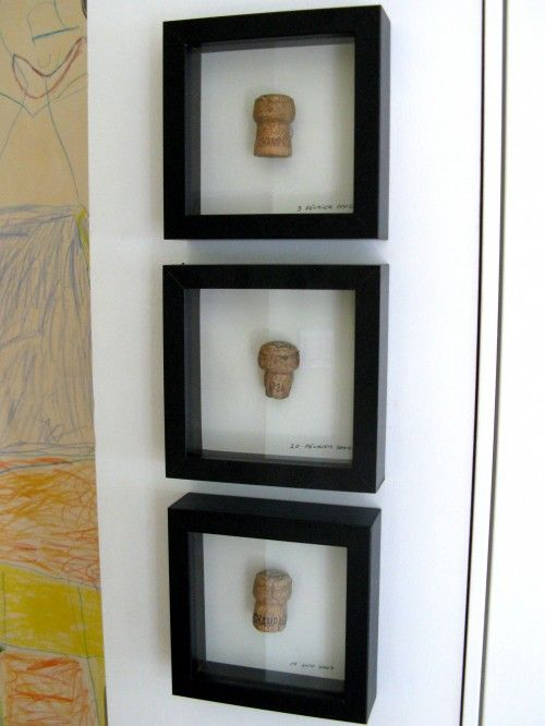 These folks framed corks from champagne bottles they opened when each of their children was born. Other ideas: put a small slit in a cork and level out the bottom to make a place-card holder for dinner parties, or use as a business card holder. Corks make great stamps for crafts! Simply carve out the design of your choice with an X-acto knife. I did this for Christmas cards this year.