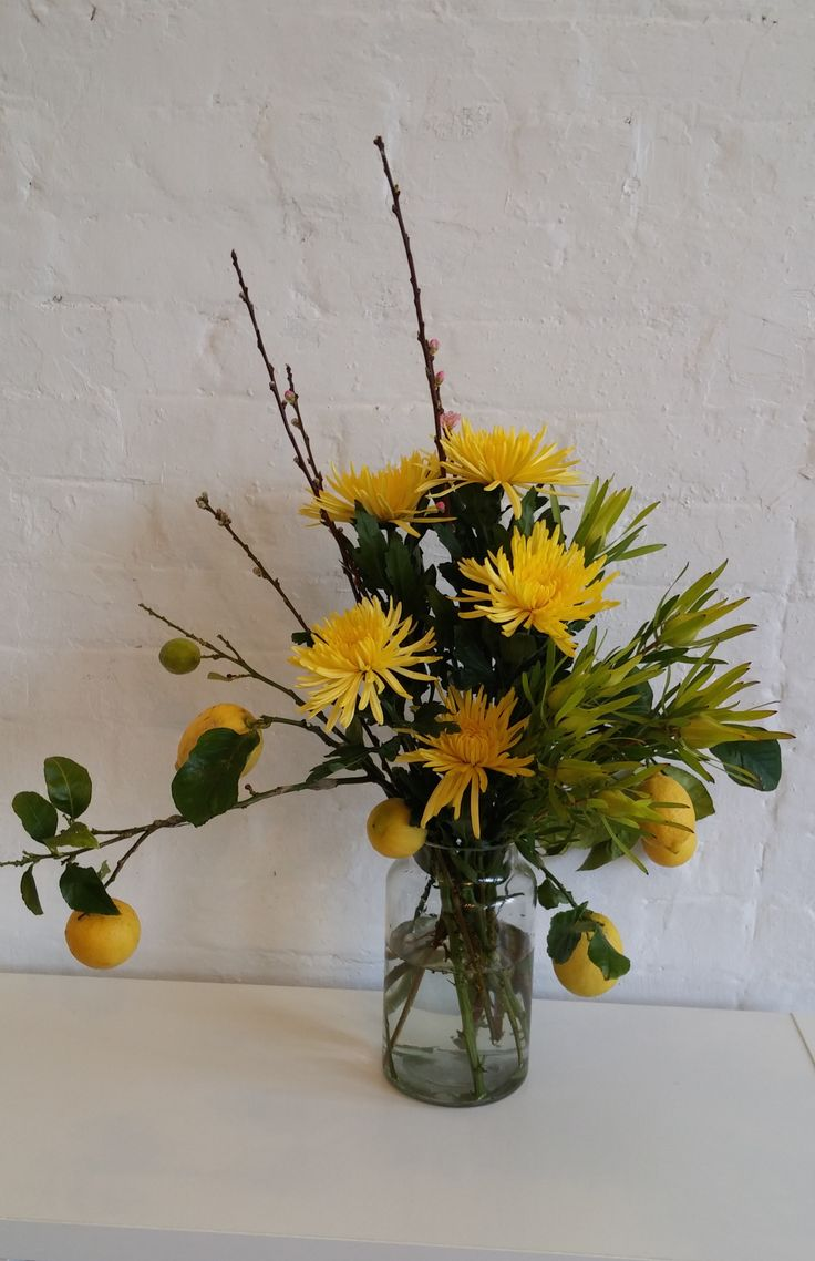ORGANIC Spring arrangement featuring lemons, crysanthemum, leucodendron and apple blossom.