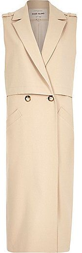 $150, Beige Sleeveless Coat: River Island Beige Structured Sleeveless Trench Jacket. Sold by River Island. Click for more info: https://lookastic.com/women/shop_items/292623/redirect