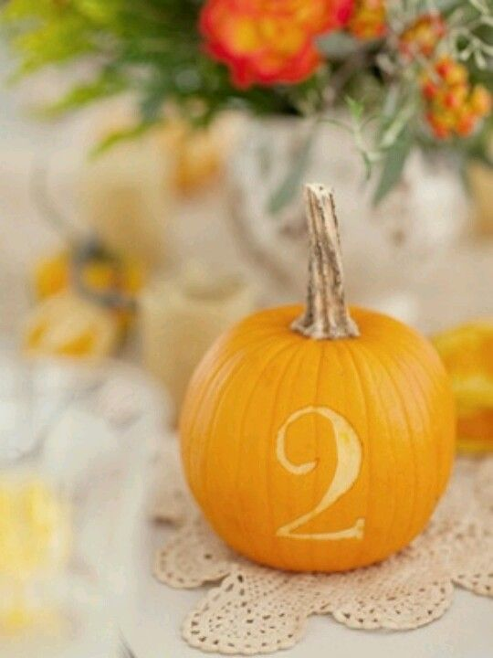 Pumpkin table number by carving the number into a pumpkin for a fall wedding!