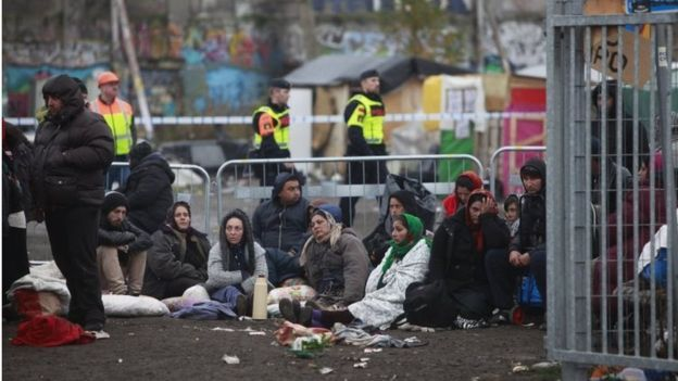 Swedish police evict migrants from a illegal camp in Malmoe, Sweden, on 3 November 2015.