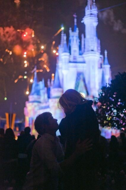 This guy deserves an award. 1. For proposing at Disney during the fireworks 2. For having it photographed. *Hopefully he asked her father first.
