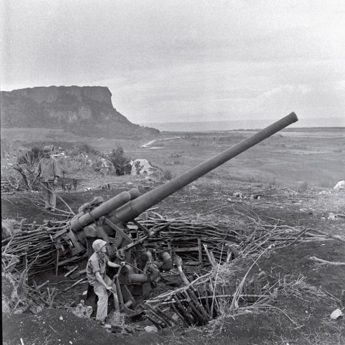 World War II: Photos We Remember | LIFE.com  Enormous piece of artillery during the Battle of Saipan in 1944.