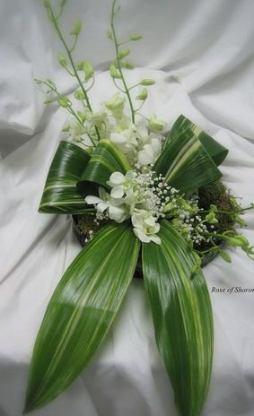Aspidistra leaves and dendrobium orchids chair decor