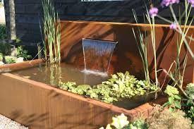 Vijver in cortenstaal (ook verkrijgbaar op maat, met vijvermuur en meerdere waterloopuitloop mogelijkheden)