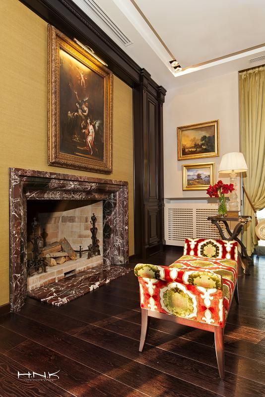 """A blend of red accents and burnt umber, oranges and vibrant turquoise, spotlights and shadows, pieces of furniture and paintings especially designed to smoothly integrate in the same tonality.  A romantic fireplace in """"Iancu Nicolae villa"""" by Hamid Nicola Katrib"""