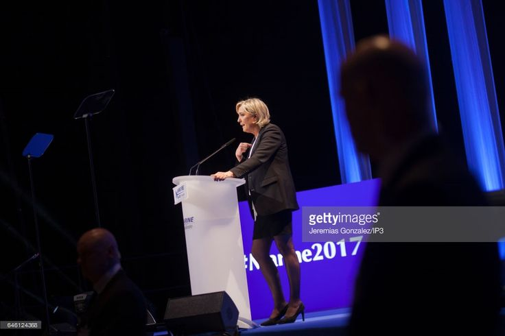 French far right National Front (FN) political party's leader, Member of the European Parliament, and candidate for the 2017 French Presidential Election Marine Le Pen delivers a speech during her meeting on February 26, 2017 in Nantes, France. Marine Le Pen of the French far right National Front (FN) political party held its meeting while the day before, clashes erupted between thousands citizens gathered to protest against her arrival in the city and against the FN and the forces of order.
