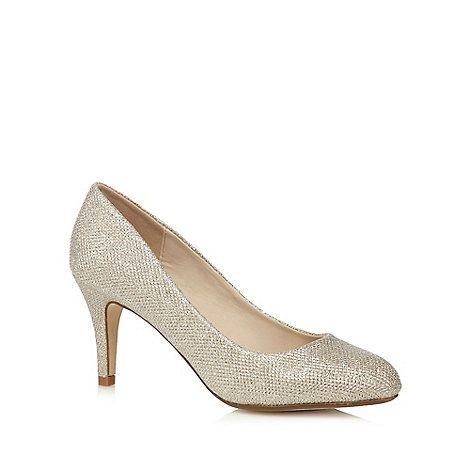 These court shoes from Debut will add a touch of sparkle to after-dark attire. Designed in seamless gold, they are beautifully embellished and flatter with a stiletto heel and rounded toe.
