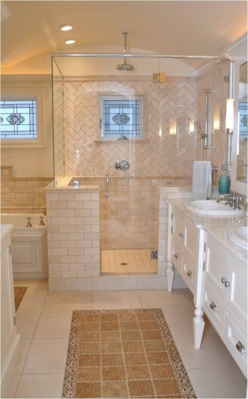 Hot and miss. Pretty bathroom. But there's no need for the tile rugs in front of the vanities.