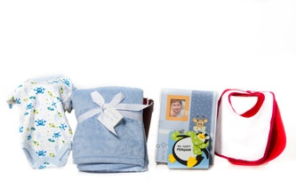"""It's A Boy!"" Basket  Baby Photo Album, StoryBook, Sleeper, a Blanket and Two Bibs.    A Little Bundle of Joy for a Baby Boy All in Blue  $55.00 CAD"