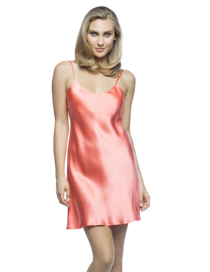 $180 Corazon Slip Du Jour in Papaya.  High-Summer partywear slip!  Living-wear at its best bias-cut silk slip, practically lined front and back neckline featuring golden adjustable spaghetti straps ideal to sparkle under the sun.