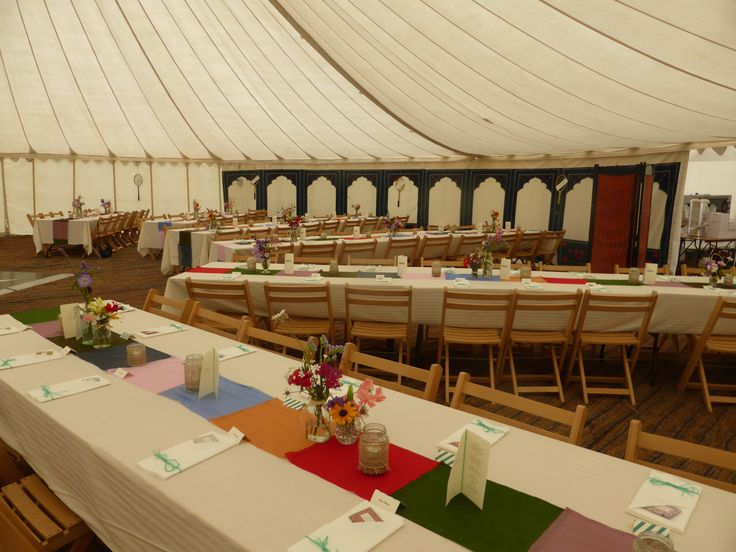 Within one of our Traditional Canvas Pole tents.