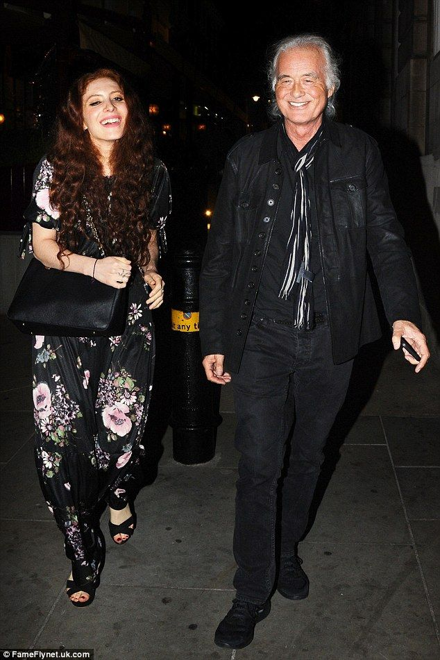 Still going strong: Led Zeppelin rocker Jimmy Page, 72, and his much younger girlfriend Scarlett Sabet, 26,were seen arriving at Loulou's in London's Mayfair to attend an intimate Van Morrison gig on Wednesday evening