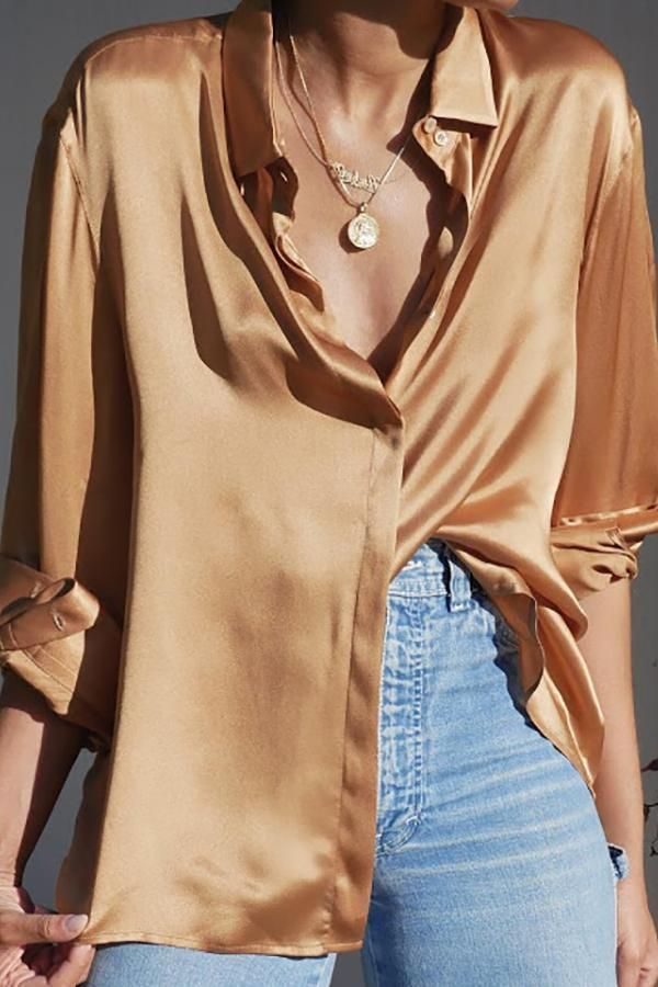 Satin shirt with gold jewelry