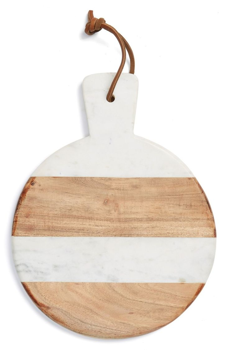 Marble and wood compose this smooth, elegantly shaped serving board ideal for showcasing appetizers or desserts when entertaining guests. This Nordstrom Anniversary Sale find will definitely be a great addition to the home. #nordstrom @nordstrom #nordstromanniversarysale