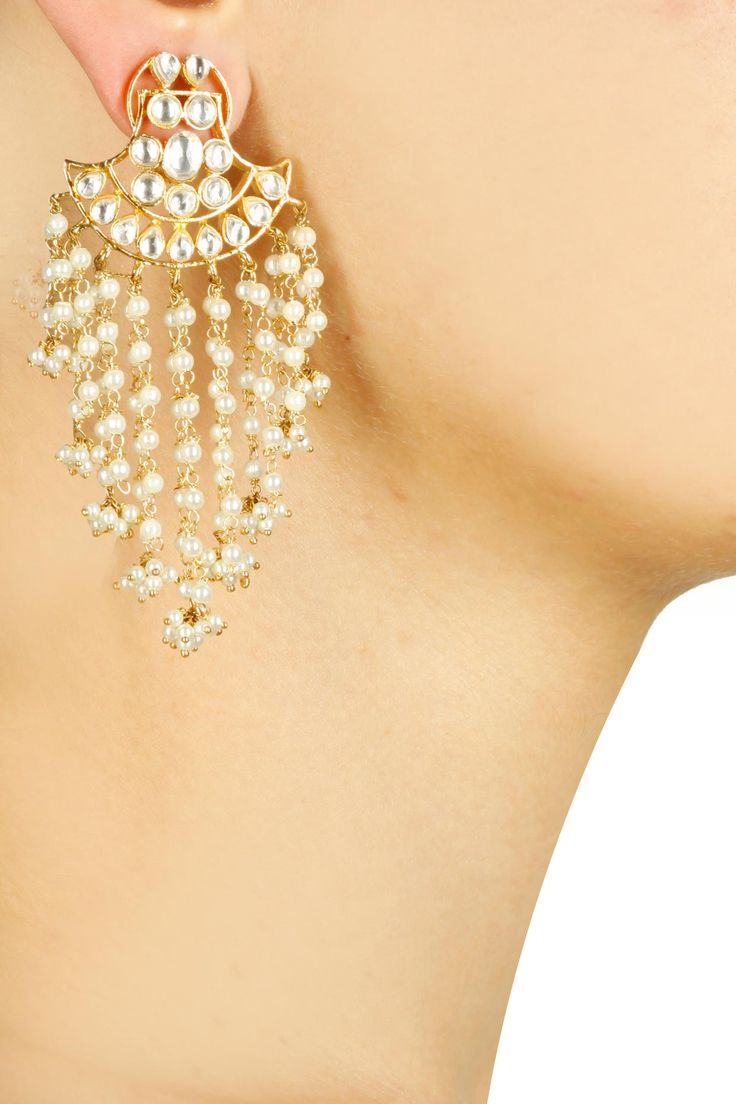 Gold finish kundan crystal and pearl string earrings available only at Pernia's…