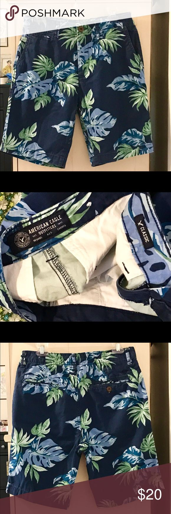 """AMERICAN EAGLE NAVY FORAL CLASSIC FIT KHAKI SHORTS Very cool, American Eagle Navy Floral Classic Fit Khaki Logo Shorts! Men's Size 30. Flawless, worn Once, for a couple of hours. From late Summer '16. They are 100 % Super soft Cotton, nice Med.-weight, not light~ Very Cool HAWAIIAN 🌺 LOOK SHORTS AE FAB QUALITY! Like New! Navy, with green, white, light & med. blues.  2 Front Slash Pockets. Small Coin Pocket in Front. 2 Back Welt Pockets, Right side buttons.  TTS! Waist: 30"""" Inseam 9.5"""" Sexy…"""
