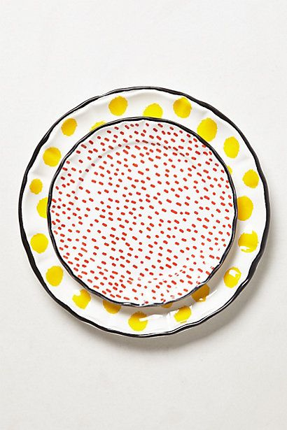 Paint along the rim and add polka dots all over plain plates; add a word or two in bold black letters; hang on the wall