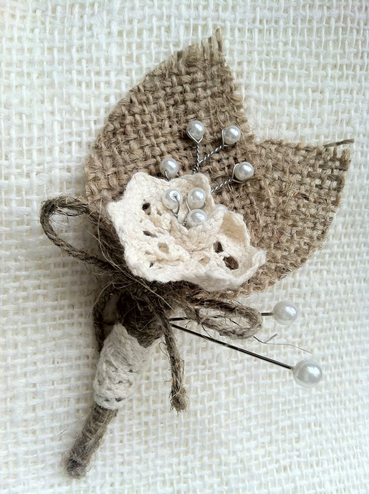 Burlap Boutonniere with Cotton Lace Flowers and Glass Pearl Beads. $10.00, via Etsy.