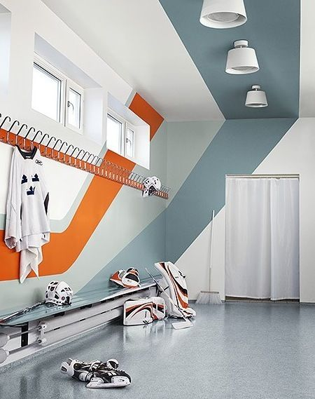 bright striped wrap locker room. stripes angles move eye along + up wall. across ceiling