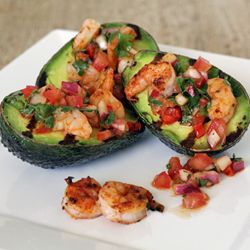 Warm and creamy grilled avocados with spicy grilled chopped shrimp in a zippy salsa. Great as a summertime paleo side dish or showy appetizer!