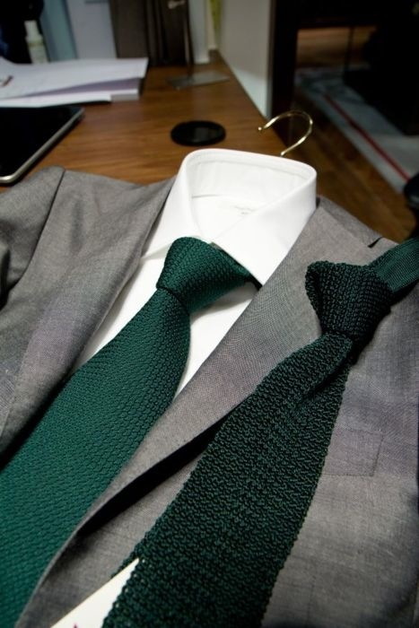 Light grey suit with green kit tie