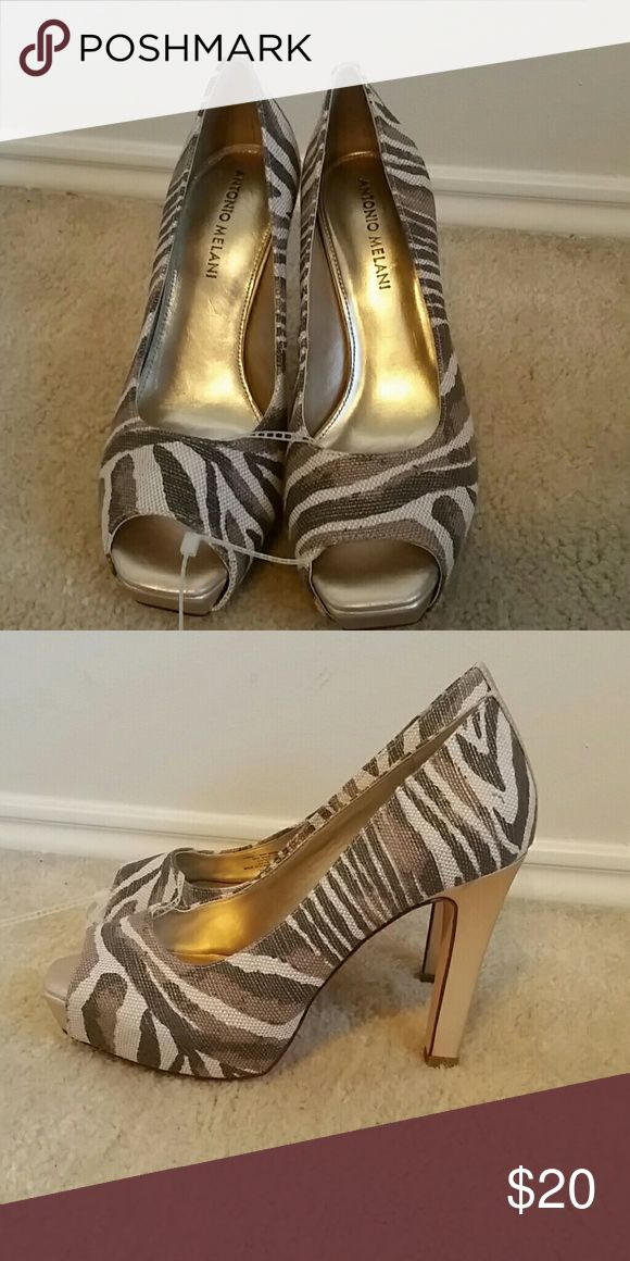 Antonio Melania gold zebra heel New condition, never worn. Gold undertones with zebra pattern. Canvas-like fabric with leather sole and lining. ANTONIO MELANI Shoes Heels
