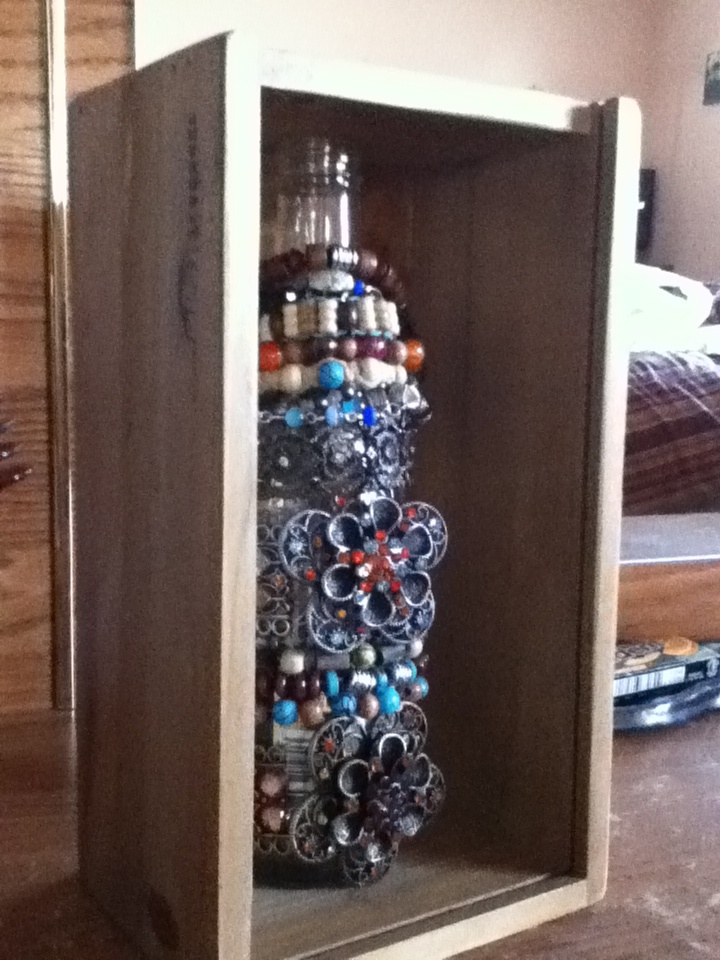 Beer bottle bracelet holder! For the wooden box I found a wooden tissue holder on clearance at Hobby Lobby for 5 bucks! Just slid the bottom off and wallah! Still waiting on the boyfriend to hook me up with his drill so I can hang it! Original idea here: http://etceteraecasa.blogspot.com/2011/07/genial.html?utm_source=feedburner&utm_medium=feed&utm_campaign=Feed%3A+EtCeteraECasa+%28et+cetera+e+casa%29&utm_content=Google+Reader
