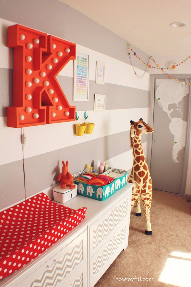 I already have a nursery I love, but there are so many perfect details in this room...polka dot garland, numbered toy boxes, closet interior, chevrons and stripes everywhere... I also love that she concluded her belly pictures with one of her holding the brand new baby.