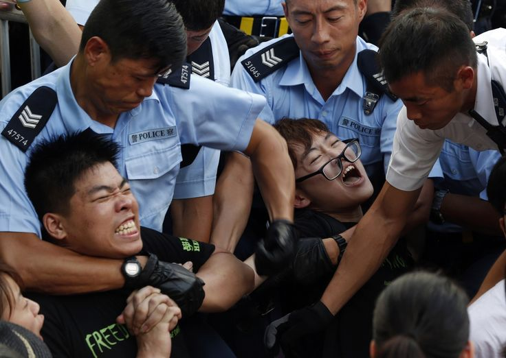 Police arrest 511 after Hong Kong democracy rally Police in Hong Kong on Wednesday arrested at least 511 demonstrators who refused to leave city streets following one of the largest pro-democracy protests in the former British territory since its return to Chinese rule in 1997. http://www.latimes.com/world/asia/la-fg-police-arrest-511-after-big-hong-kong-democracy-rally-20140701-story.html