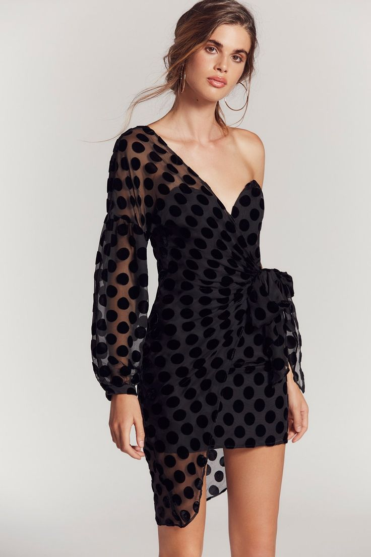 Caught Out Draped Dress | Beautiful dress featuring velvet dots throughout and an unexpected silhouette with a sheer, one sleeve design and effortless, wrapped overlay. * Hidden side zipper closure * Wire at the center bust for added shape * Lined