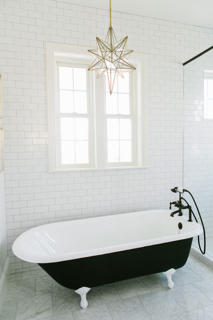 192 best interiors bathroom images on pinterest bathroom ideas white and black contrast tub with white subway tile walls and hanging star light fixture house of jade dailygadgetfo Images