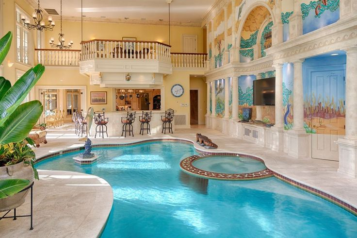 Mediterranean Swimming Pool with Indoor pool, Pool with hot tub, exterior stone floors, exterior tile floors
