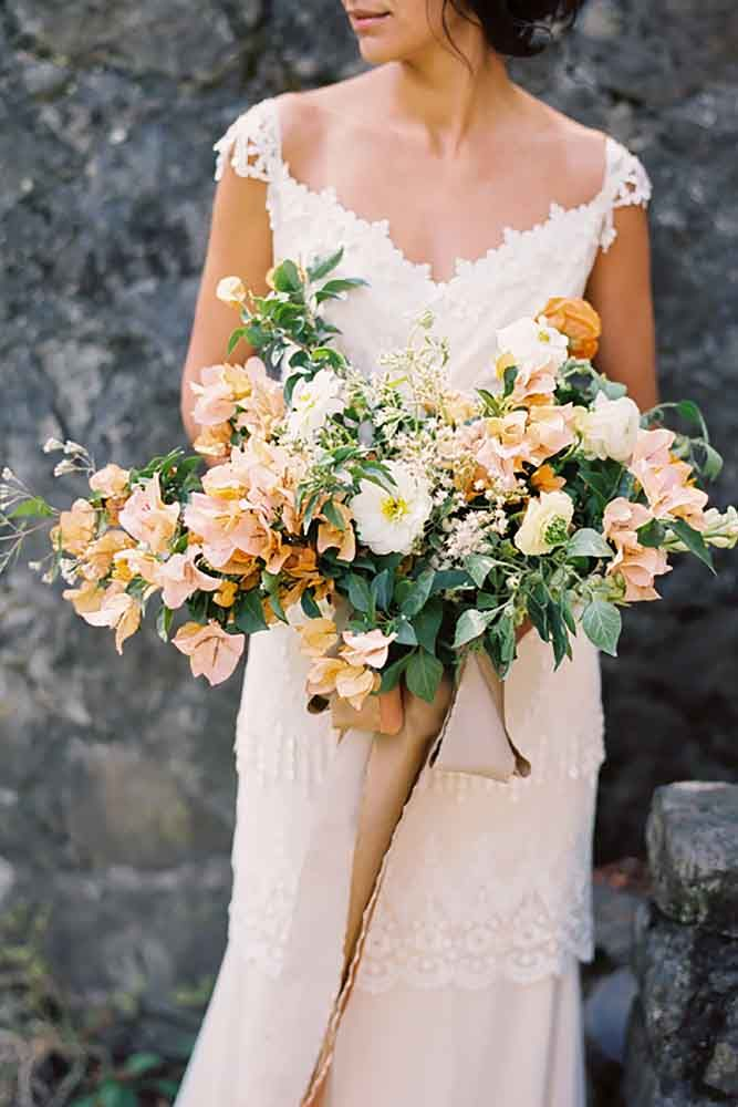 18 Bohemian Wedding Bouquets That Are Totally Chic ❤ Bohemian chic wedding bouquets are full of whimsical details, wild flowers and feathers. See more: http://www.weddingforward.com/bohemian-wedding-bouquets/ #weddings #bouquets