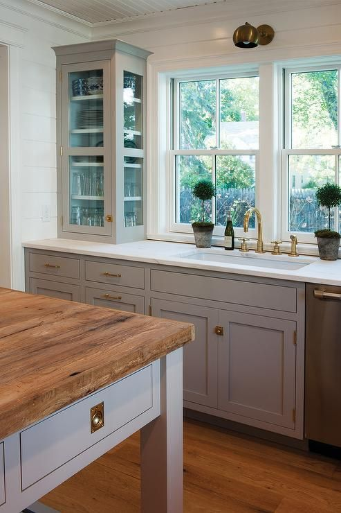 Stunning kitchen with light gray cabinets painted Farrow & Ball Dove Tale…