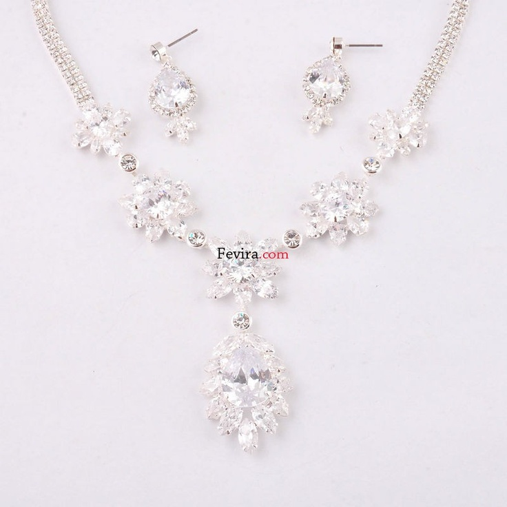 *Charming and lovely, this necklace and earring set features rhinestones, fashion design. Perfect for your spring or wedding.*This lovely necklace is completed with matching earrings. A gorgeous set for any occasion. Price $39.95